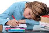 Tired child doing homework — Stock Photo