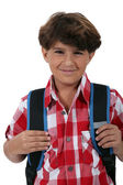 Schoolboy with satchel — Stock Photo