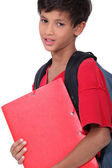 Schoolboy holding a folder — Stock Photo