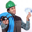 Plumber holding his wages — Stock Photo #16478271