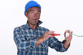 Tradesman suffering from electric shock — Stock Photo
