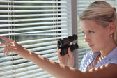 A spy peering through some blinds — Stock Photo