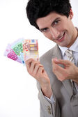 Rich businessman showing off his money — Stock Photo