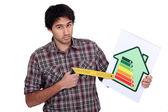 Artesano muestra la tasa de consumo de energía — Foto de Stock