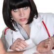 Female doctor bandaging wrist — Stock Photo #16487149