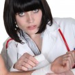 Stockfoto: Female doctor bandaging wrist