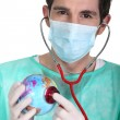 General practitioner with globe — Stock Photo