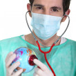 General practitioner with globe — Stock Photo #16487381