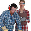 Stock Photo: Male and female joiners working together