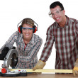 Stock Photo: Couple sawing wood