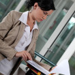 Young businesswoman looking at her documents — Stock Photo