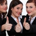 Три девушки, давая палец вверх — Стоковое фото