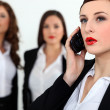 Sexy businesswomen with a cellphone — Stock Photo