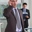Businessman talking on his mobile phone — Foto de Stock