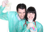 Cheerful medical duo wearing blouse with globe — Stock Photo