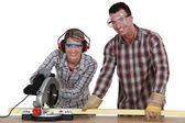 Couple sawing wood — Stock Photo