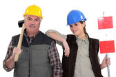 A manual worker and his trainee. — Stock Photo