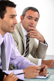 Two men sat on interview panel — Stock Photo