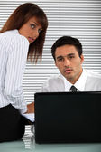Two eager business working overtime — Stock Photo