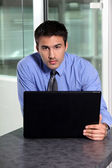 Young businessman using laptop computer — Stock Photo