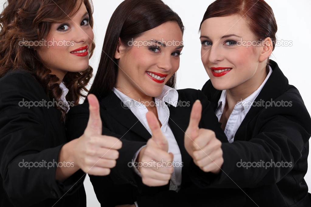 Three businesswomen giving the thumbs-up — Stock Photo #16488327