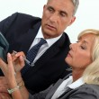 Stock Photo: Middleaged businessmwith female counterpart