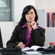 Stock Photo: Brunette office worker thinking