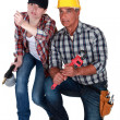 Stock Photo: Male and female workers crouching