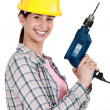 Stock Photo: Womwith drill