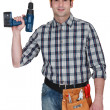 Carpenter holding drill — Foto de stock #16494583