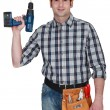 Carpenter holding drill — Stock Photo