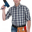 Man holding heat torch - Stock Photo