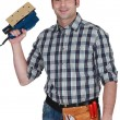 Man with an electric sander — Stock Photo