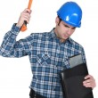 Man hammering a laptop computer - Photo