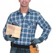 Mason holding two bricks — Stock Photo #16495221