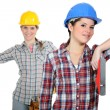 Stock Photo: Female builders with wood