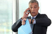 Businessman realizing he is late — Stock Photo