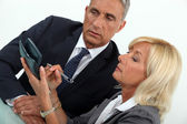 Middleaged businessman with female counterpart — Stock Photo