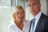 Mature business couple — Stock Photo