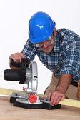 Carpenter using saw mounted to work surface — Stock Photo
