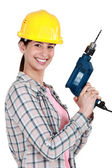 Woman with a drill — Foto Stock