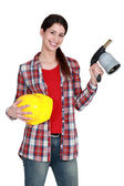 Craftswoman holding a welding torch — Stock Photo
