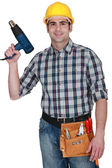 Man holding heat torch — Stock Photo