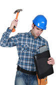 Man hammering a laptop computer — Stock Photo
