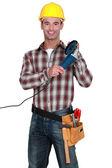 Tradesman holding an angle grinder — Stock Photo