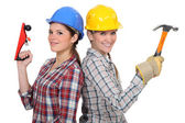 Tradeswomen holding tools — Stock Photo