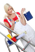 Young woman with plaits preparing to decorate in bright colours — Stock Photo