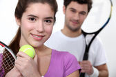 Young couple dressed for tennis — Stock Photo