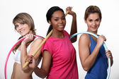 Three women limbering up at the gym — Stock Photo