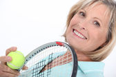 Mature woman liking tennis — Stock Photo